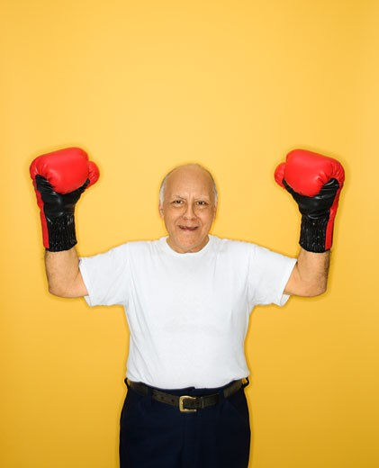 Caucasian mature adult male wearing boxing gloves. : Stock Photo