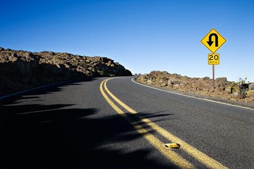 Road and curve in road sign in Haleakala National Park, Maui, Hawaii. : Stock Photo