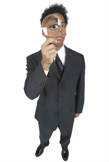 Stock Photo: 1525R-10099 Business man with a magnifier