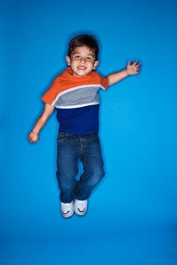 Male Hispanic boy jumping. : Stock Photo