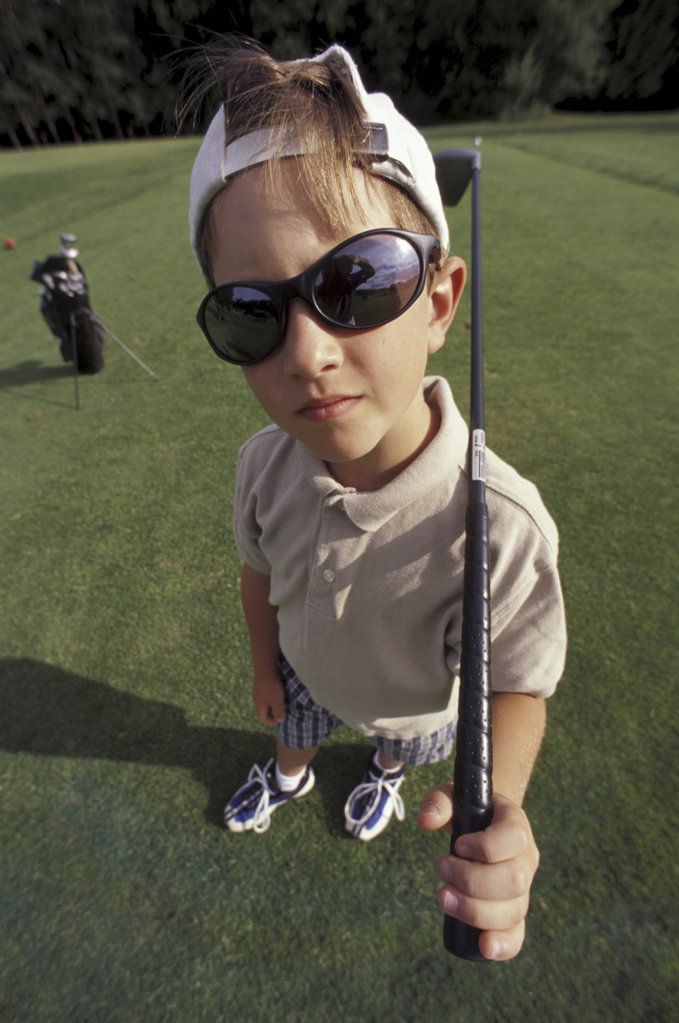 little boy posing with a golf club : Stock Photo