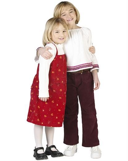 Smiling blonde girls hugging  : Stock Photo