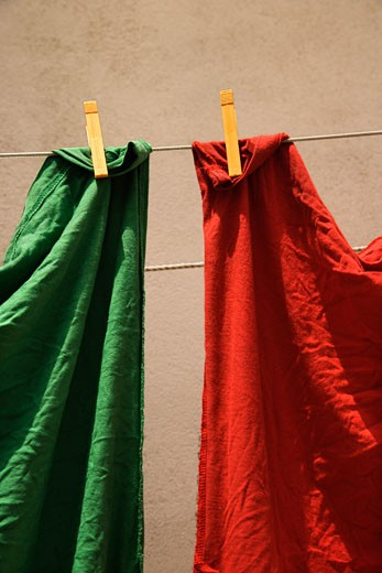 Red and green fabric hanging on clothesline in Lisbon, Portugal. : Stock Photo