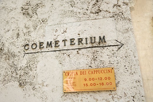 Sign with arrow directing towards coemeterium in Rome, Italy. : Stock Photo