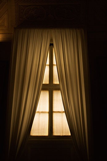 Stock Photo: 1525R-102191 Dimly lit window with drapes in the Vatican Museum, Rome, Italy.
