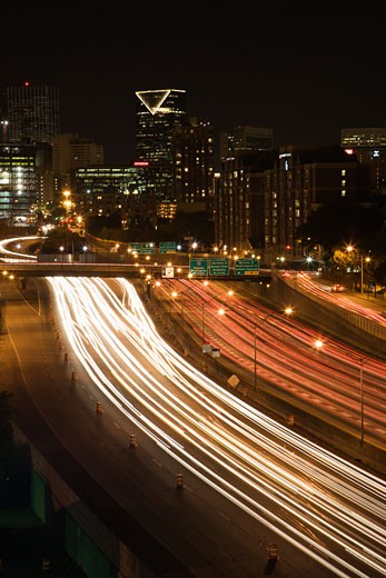 Stock Photo: 1525R-102768 Nightscape of Atlanta, Georgia skyline with blurred automobile lights on highway in foreground.