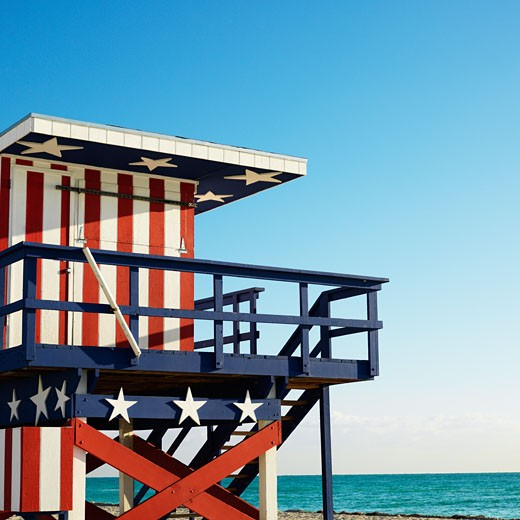 Stock Photo: 1525R-102811 Lifeguard tower painted red, white and blue with stars and stripes on beach in Miami, Florida, USA.