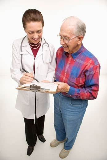 Mid-adult Caucasian female doctor showing papers to elderly Caucasian male. : Stock Photo