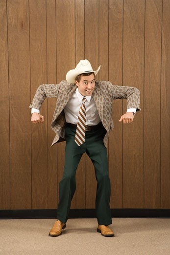 Mid-adult Caucasian male wearing cowboy hat dancing. : Stock Photo