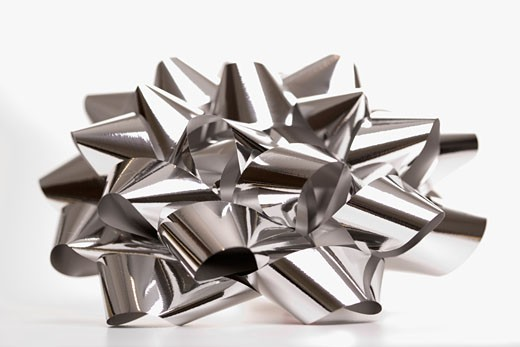 Still life of big shiny silver Christmas bow. : Stock Photo