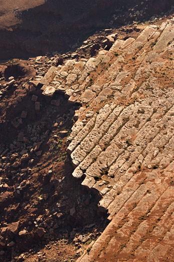 Aerial of deteriorating rock cliff in high desert of Utah, USA. : Stock Photo