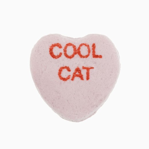 Stock Photo: 1525R-105173 Purple candy heart that reads cool cat against white background.