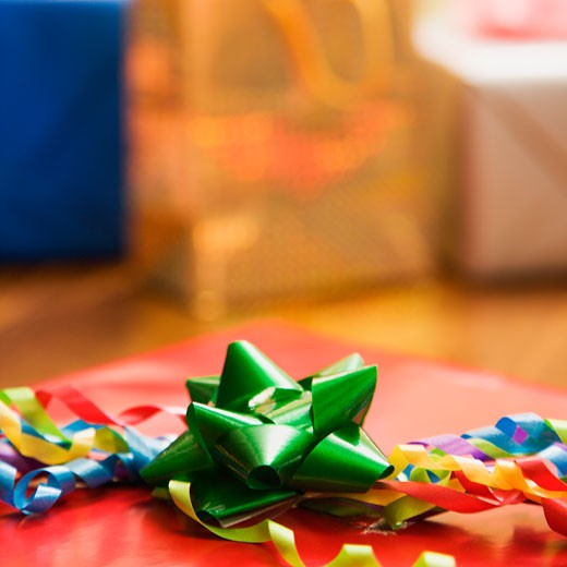 Stock Photo: 1525R-105337 Presents wrapped and decorated with bows on a table.