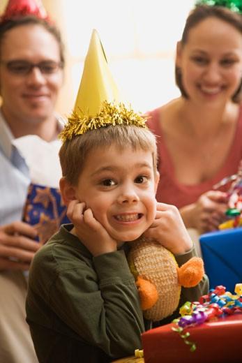 Caucasian boy at  birthday party looking at viewer making facial expression. : Stock Photo