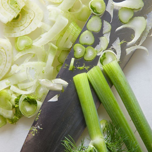 Close up of chopped fennel with large kitchen knife. : Stock Photo