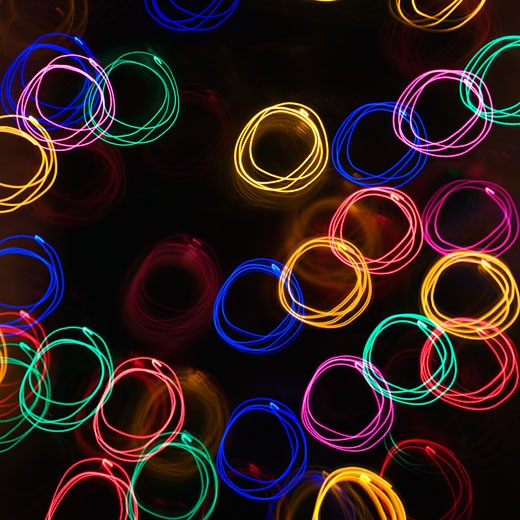Multicolored lights forming abstract circle pattern from motion blur. : Stock Photo