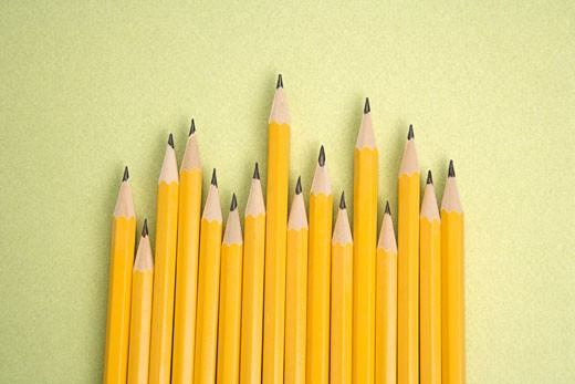 Stock Photo: 1525R-106013 Sharp pencils arranged in an uneven row.