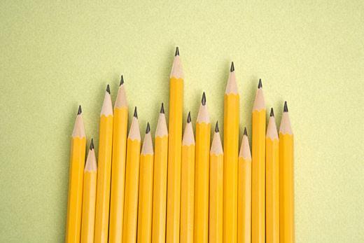 Sharp pencils arranged in an uneven row. : Stock Photo