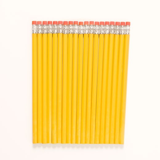 Group of new unsharpened pencils lined up in an even row.  : Stock Photo