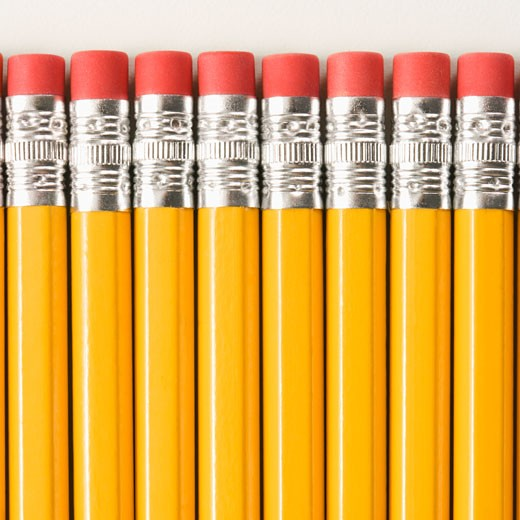 Eraser ends of group of pencils lined up in an even row.  : Stock Photo