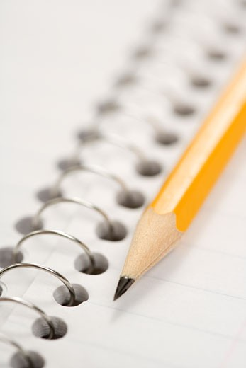 Stock Photo: 1525R-106183 Close up of pencil on top of spiral bound notebook.