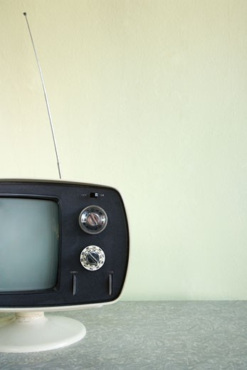 Still life of vintage television set with antenna raised. : Stock Photo