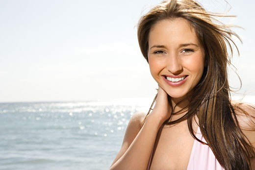 Portrait of pretty young smiling Caucasian woman with long brown hair at beach in Maui Hawaii. : Stock Photo