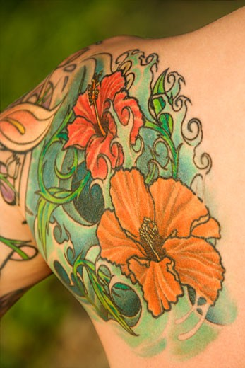 Stock Photo: 1525R-107769 Close up of floral tattoo on shoulder of Caucasian woman.