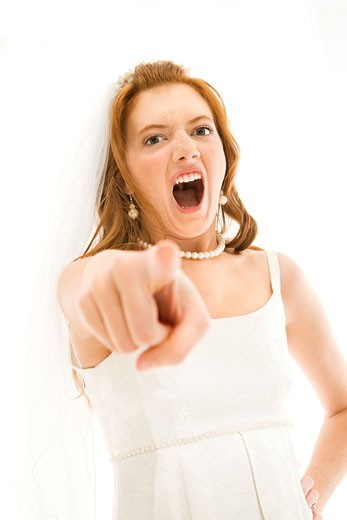 Stock Photo: 1525R-107944 Caucasian bride screaming and pointing finger at viewer.