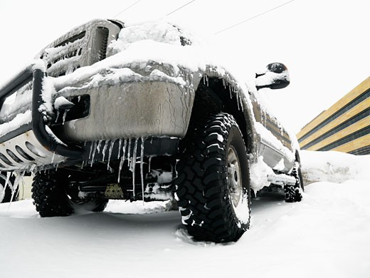 Stock Photo: 1525R-108297 Big SUV covered in snow and ice.