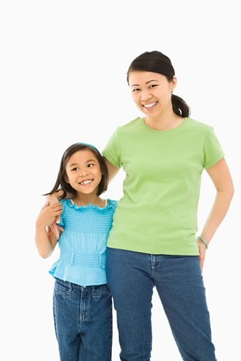 Stock Photo: 1525R-108469 Asian mother and daughter standing with arms around eachother.
