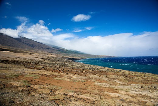 Barren landscape leading to Pacific ocean in Maui, Hawaii. : Stock Photo