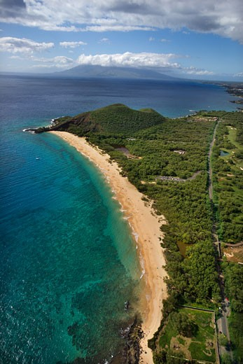 Aerial of coastline with sandy beach and Pacific ocean in Maui, Hawaii. : Stock Photo