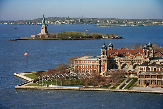 Stock Photo: 1525R-109979 Aerial view of Ellis Island with Statue of Liberty, New York City.