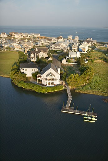 Stock Photo: 1525R-110594 Aerial view of houses and ocean at Bald Head Island, North Carolina.