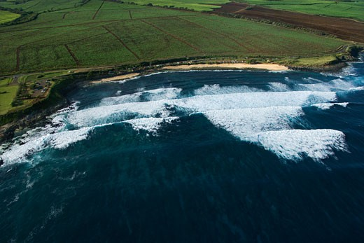 Aerial view of surf spot on coast of Maui, Hawaii with waves. : Stock Photo