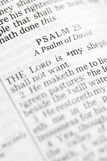 Selective focus of Psalm verses in open Holy Bible. : Stock Photo