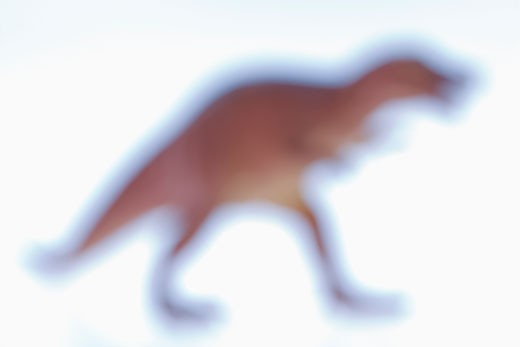 Blurred toy Tyrannosaurus dinosaur. : Stock Photo