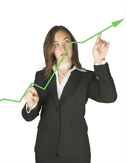 business woman pointing at a green graph : Stock Photo