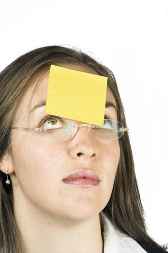Stock Photo: 1525R-112191 business woman with post-it note on her head