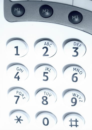Stock Photo: 1525R-112339 close up of a keypad on cyan