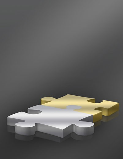Stock Photo: 1525R-112535 business gold and silver puzzle pieces