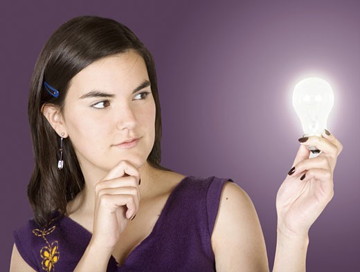 creative woman thinking of ideas over purple : Stock Photo