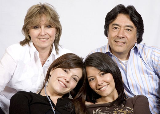 latin american family over a light grey background : Stock Photo