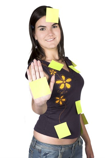 casual girl with lots of tasks to do over white : Stock Photo