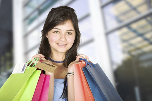 Stock Photo: 1525R-113050 beautiful teenager with shopping bags in a shopping mall