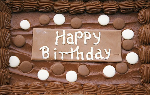 birthday cake in chocolate flavour with the words happy birthday : Stock Photo