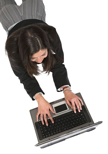 Stock Photo: 1525R-113141 business woman working on laptop over white
