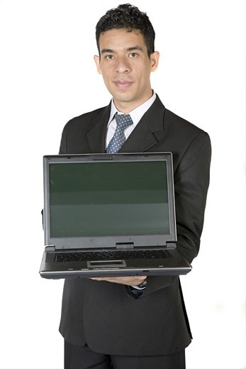 Stock Photo: 1525R-113192 business man with laptop over a white background
