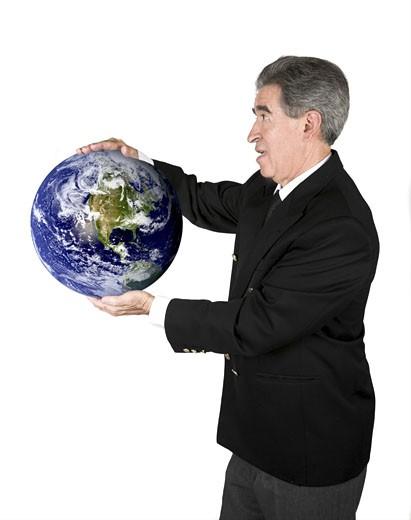 Stock Photo: 1525R-113197 business man holding globe over white - globe taken from http://www.nasa.gov
